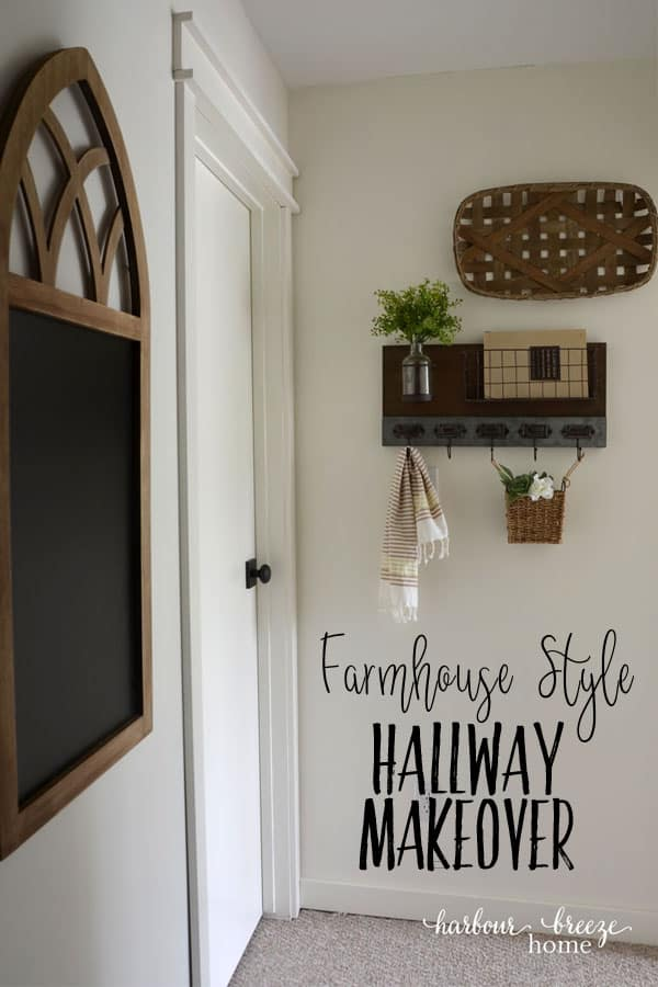 white bedroom door with oil rubbed bronze Schlage door knob and farmhouse decor on the walls around it