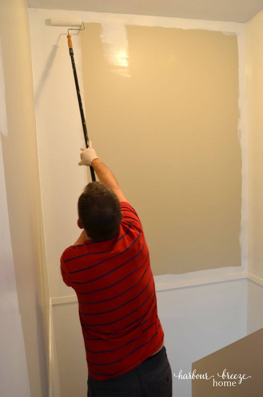 Benjamin Moore Simply White paint being painted in a stairwell