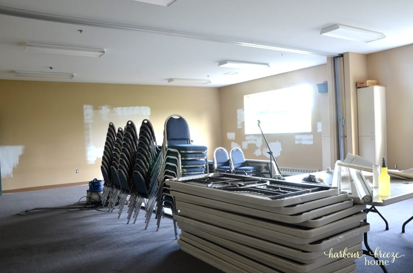 A large classroom in need of fresh painted walls.