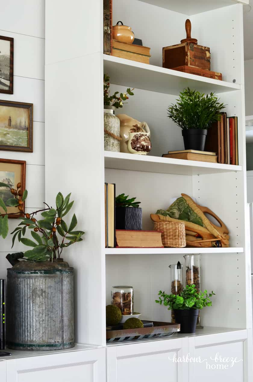 Bookcase styling with vintage decor