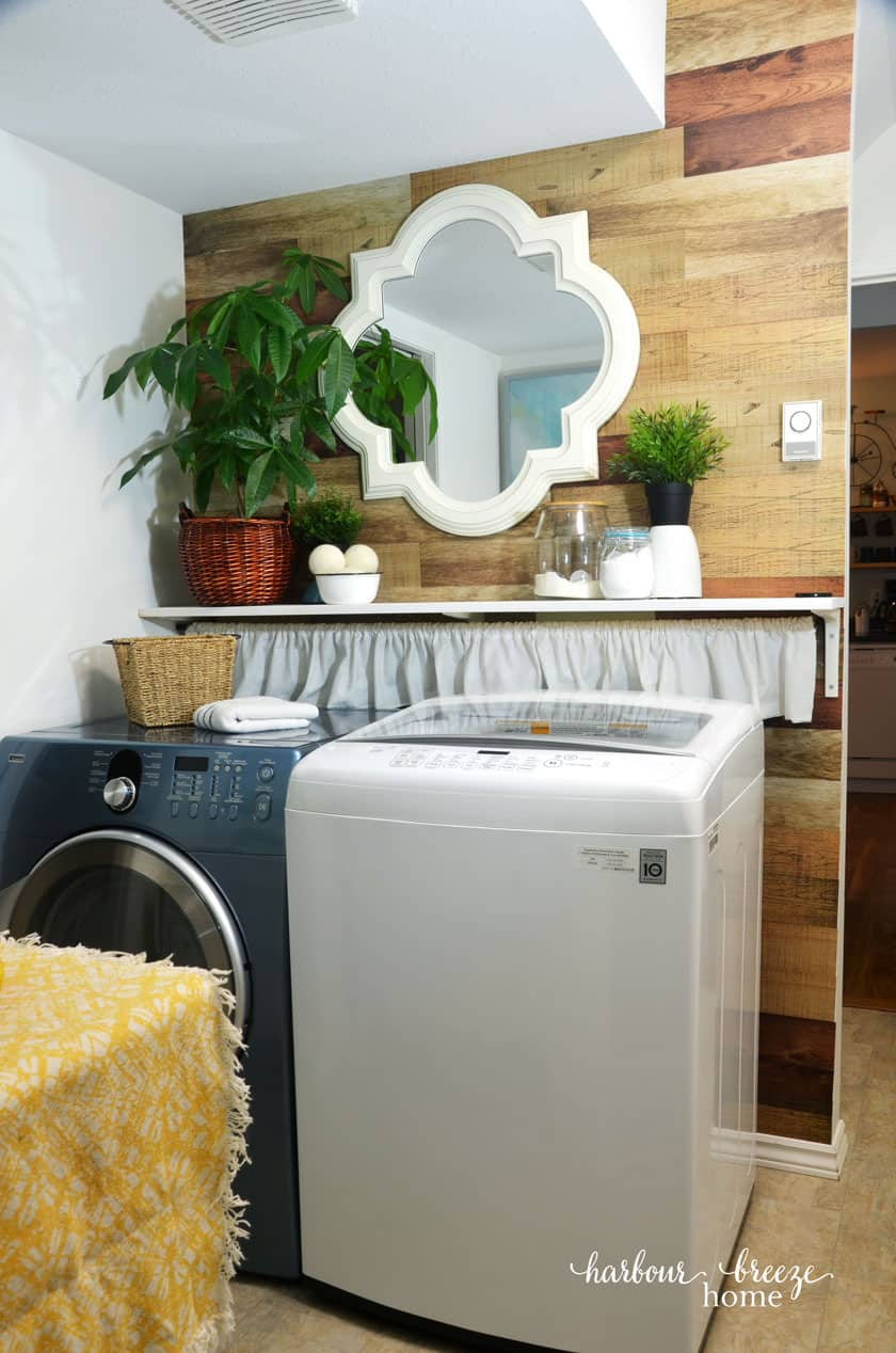 Farmhouse style Laundry Room with wood wall accent