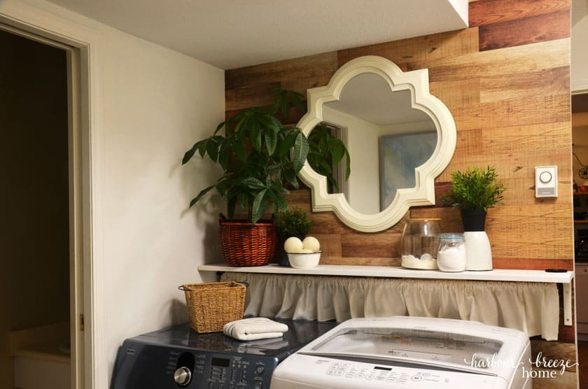 Wood Plank Wall stickers with large mirror on wall above a washer and dryer