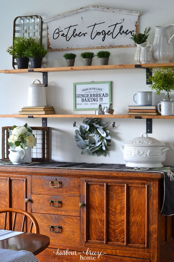DIY Fixer Upper wall shelves decorated with farmhouse decor for Winter above a Dining Room buffet.