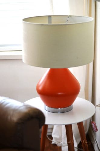 Orange Table lamp sitting on a living room end table