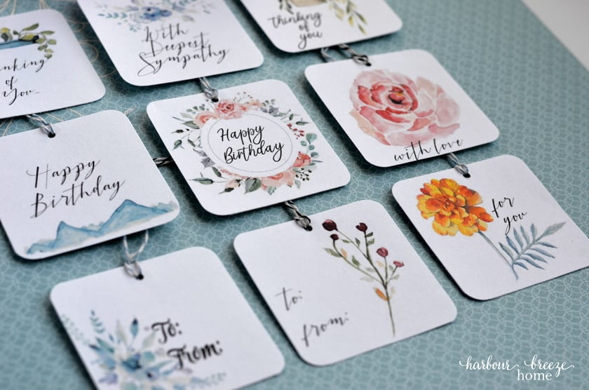 These pretty tags include watercolor pictures of flowers, plants, and mountains.
