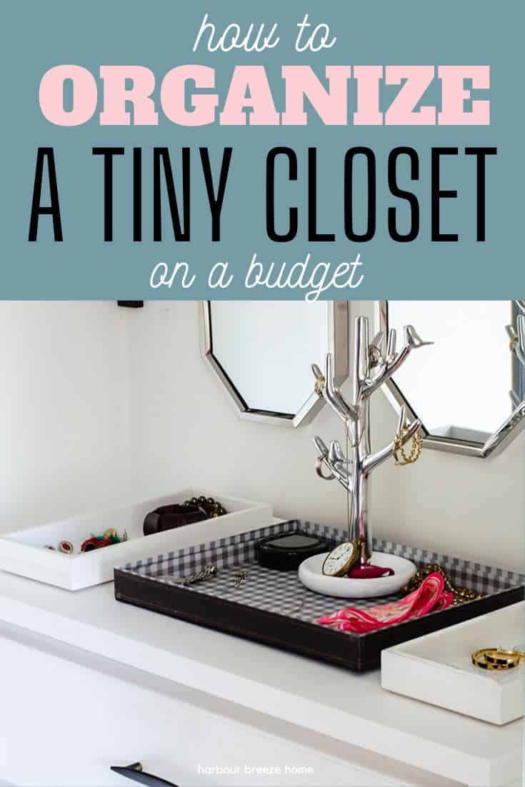 "A white dresser inside a closet with a tray with jewelry on the top. Caption reads, ""How to Organize a Tiny Closet on a Budget""."