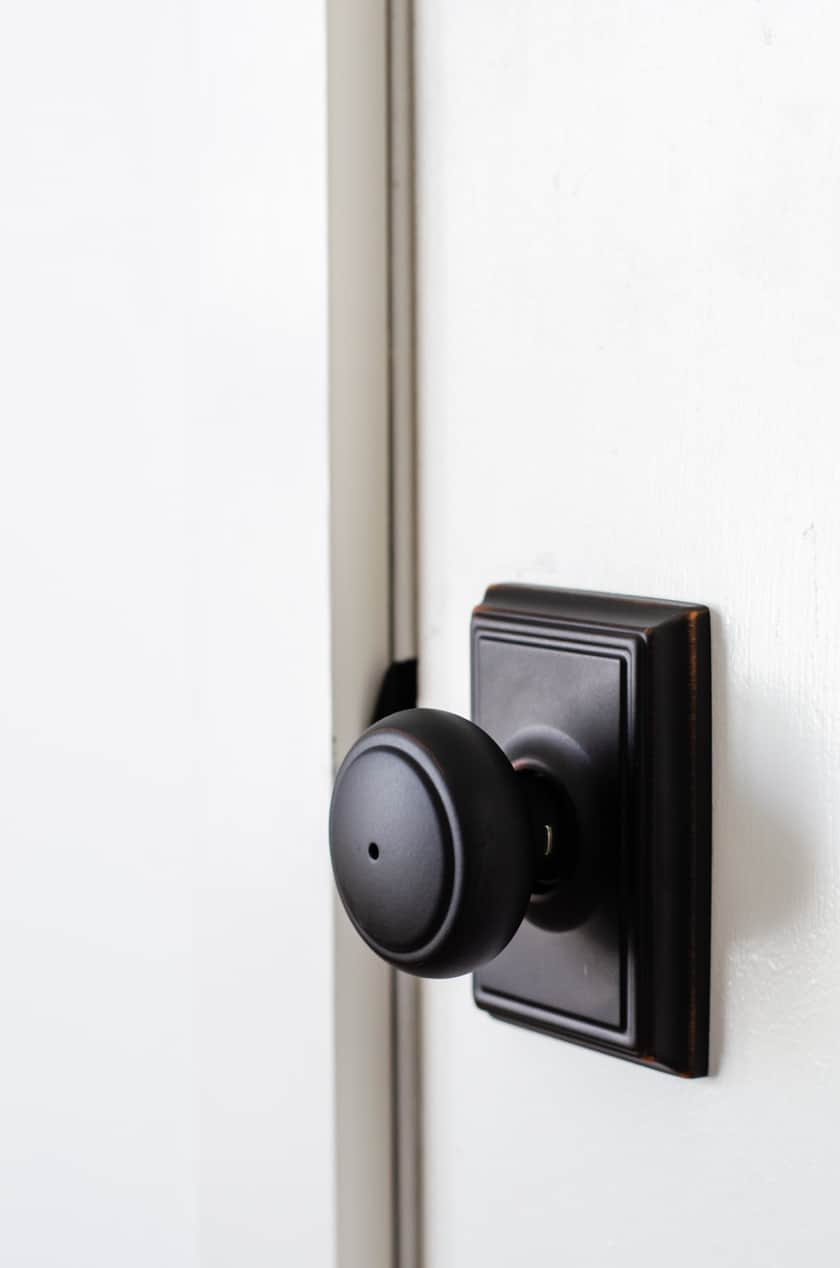 Modern Bedroom Doorknob from Schlage - black with square plate behind knob