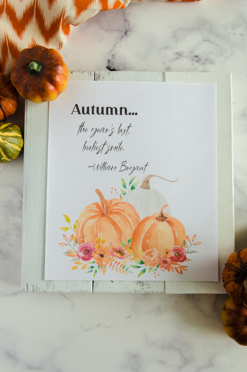 """Fall art printable with watercolor pumpkins and the saying """"Autumn...the year's best lovelist smile"""""""
