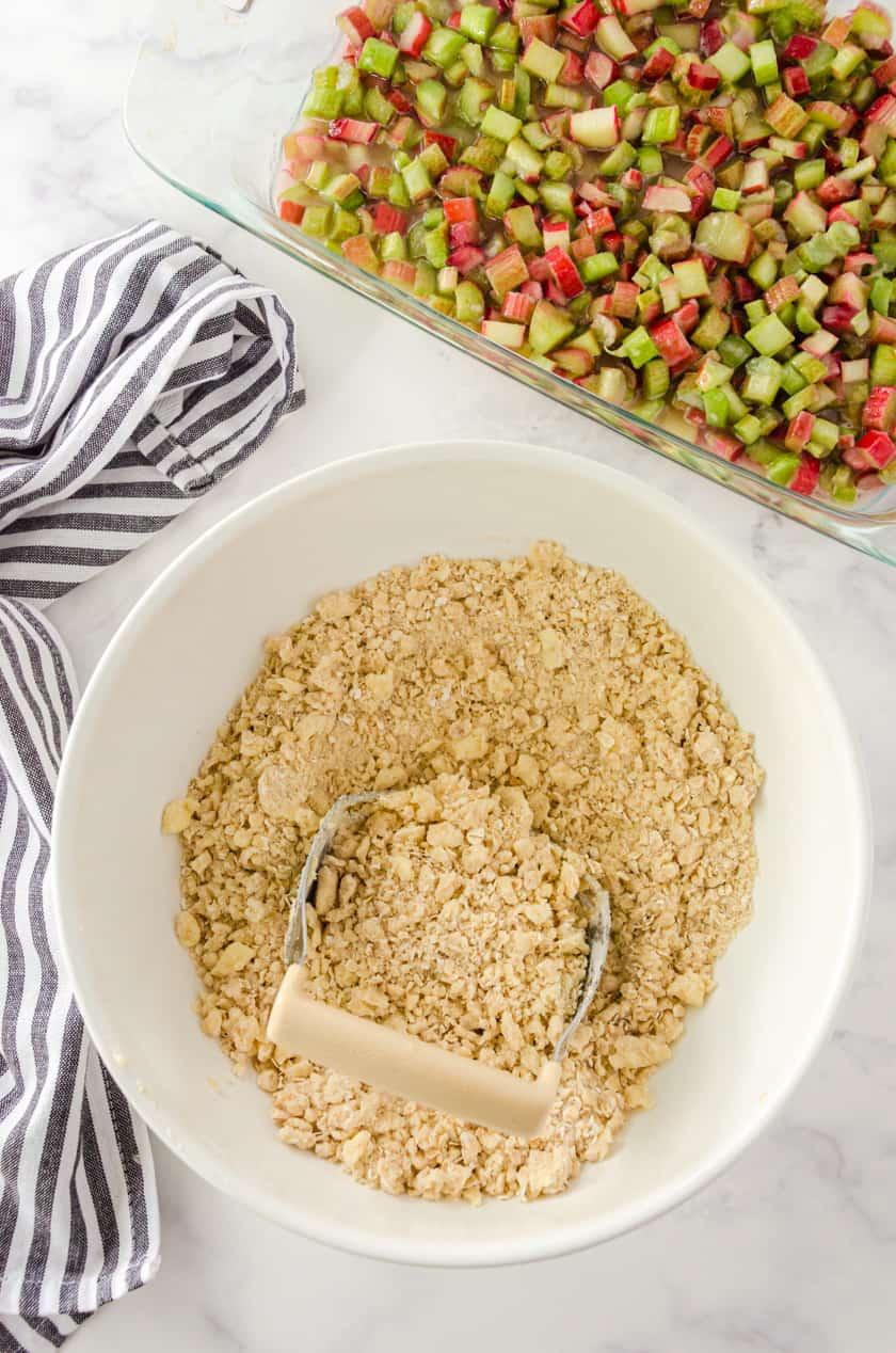 Bowl of oatmeal topping for rhubarb crisp.