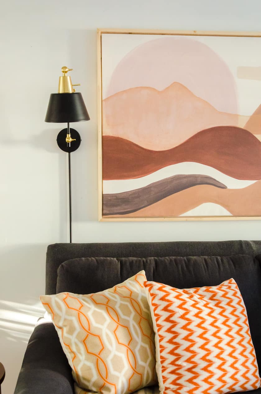 Changing out summer colored throw pillows for the cozy colors of Fall is another quick and easy room decor idea.