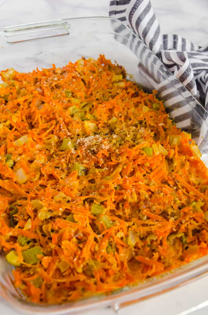 Cheesy Carrot casserole in a dish hot out of the oven is a perfect side dish for Christmas or Thanksgiving dinner.