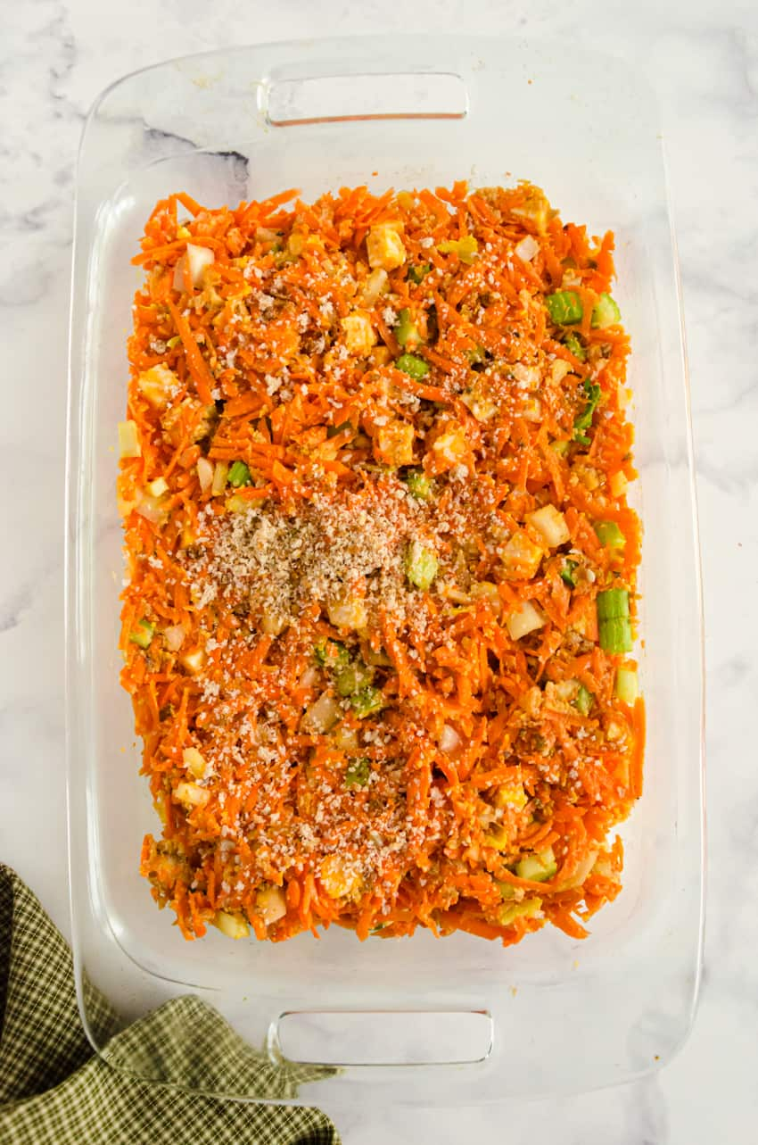 Cheesy Carrot Casserole ingredients in a large baking dish.