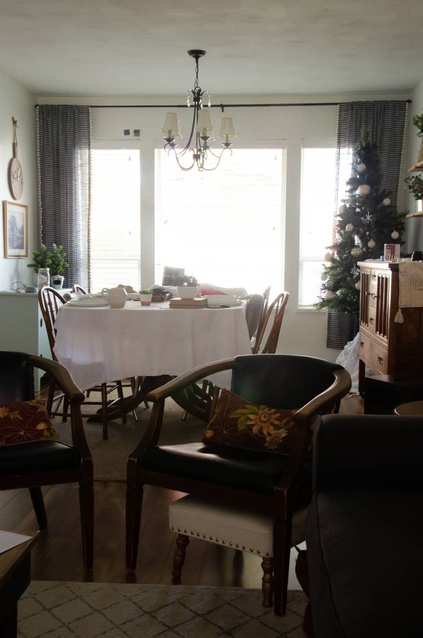 a dining room before a dark painted accent wall was added