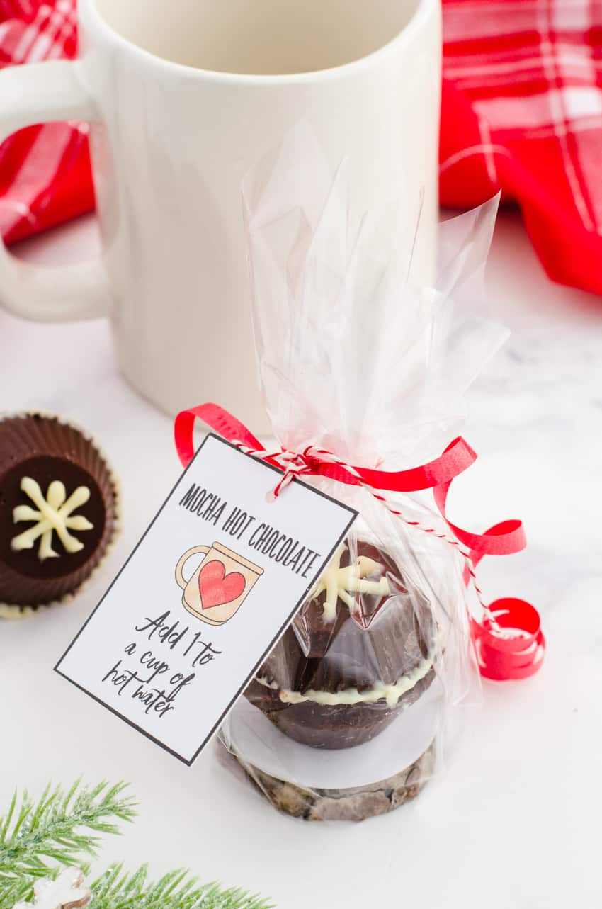Chocolate Bomb Recipe turned into a Christmas gift by wrapping it individually with cellophane and tying with a printable gift tag for mocha hot chocolate bomb