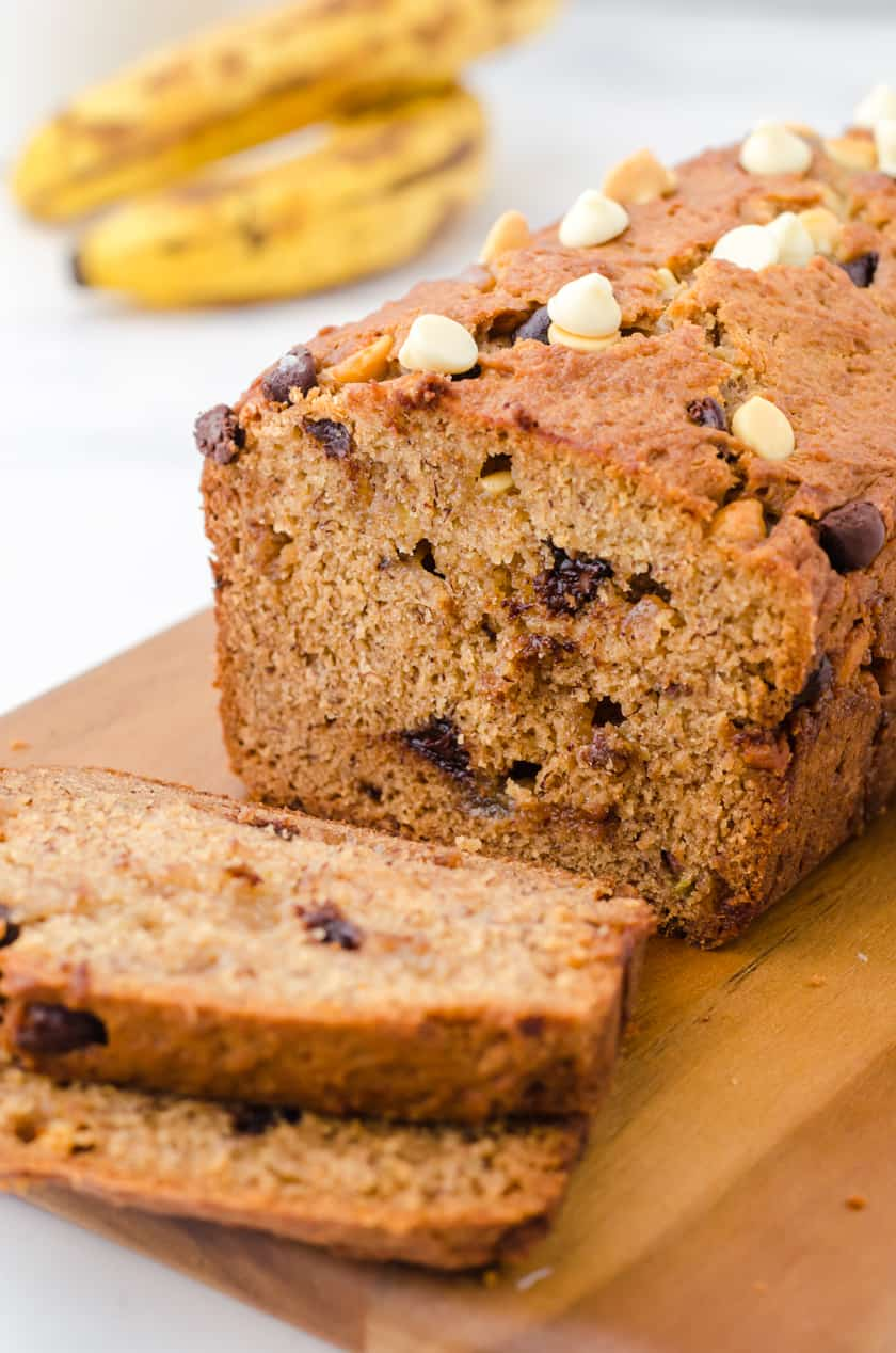 Sliced peanut butter chocolate chip banana bread on a cutting board.