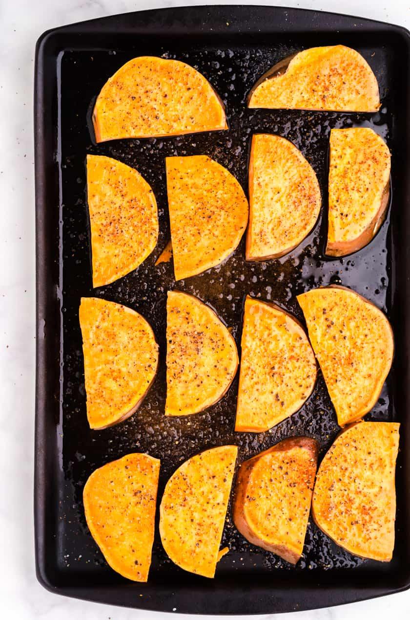 Sliced sweet potato on baking sheet