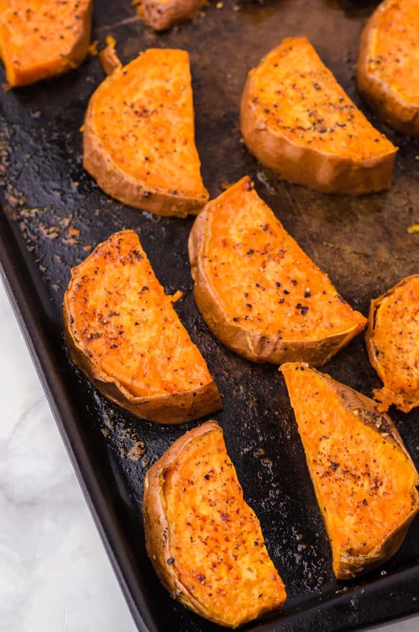 Oven baked sweet potatoes on a baking sheet