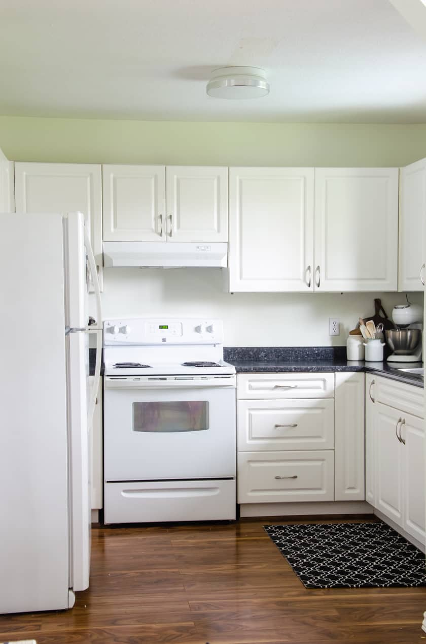 Small kitchen painted in Simply White paint color for a budget friendly small kitchen remodel upgrade.