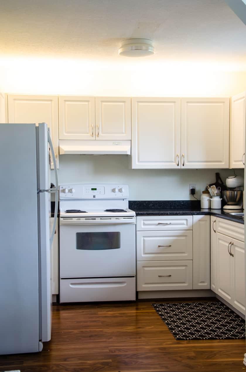 kitchen after above kitchen cabinet lighting is installed