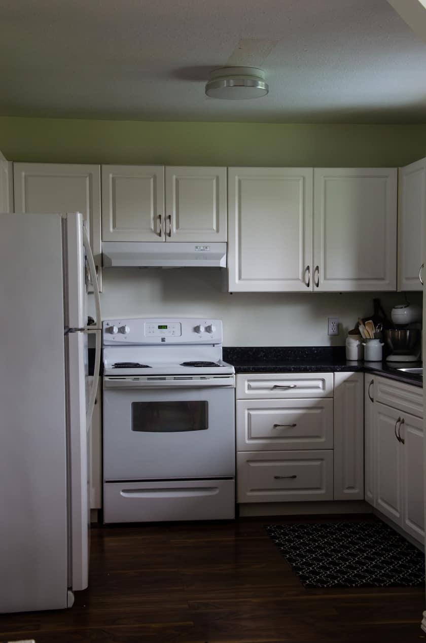 kitchen before upper cabinet lighting was installed