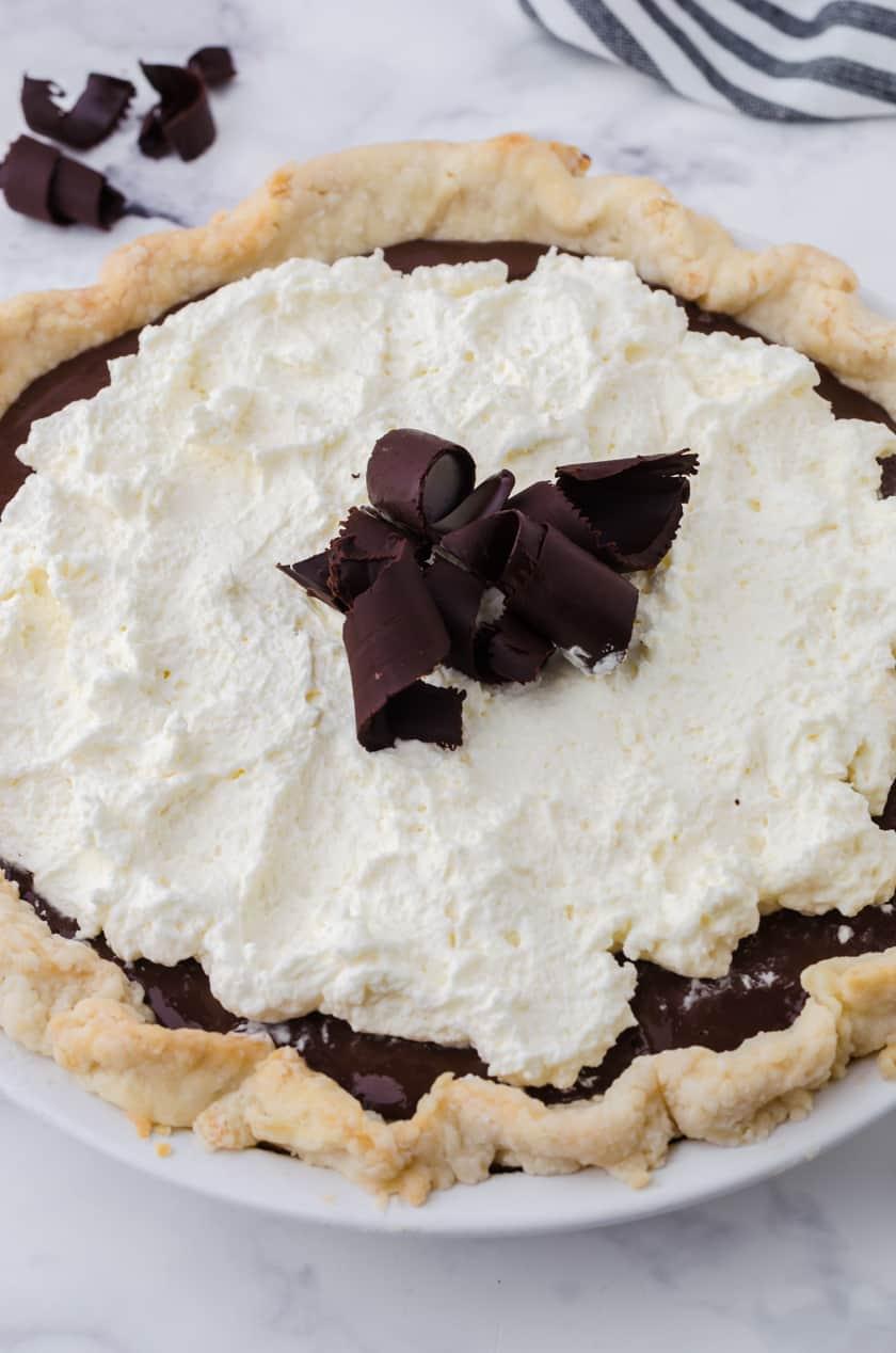 Close up of a whole chocolate cream pie.