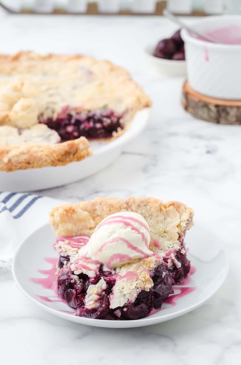 Homemade cherry pie with cherry glaze and ice cream