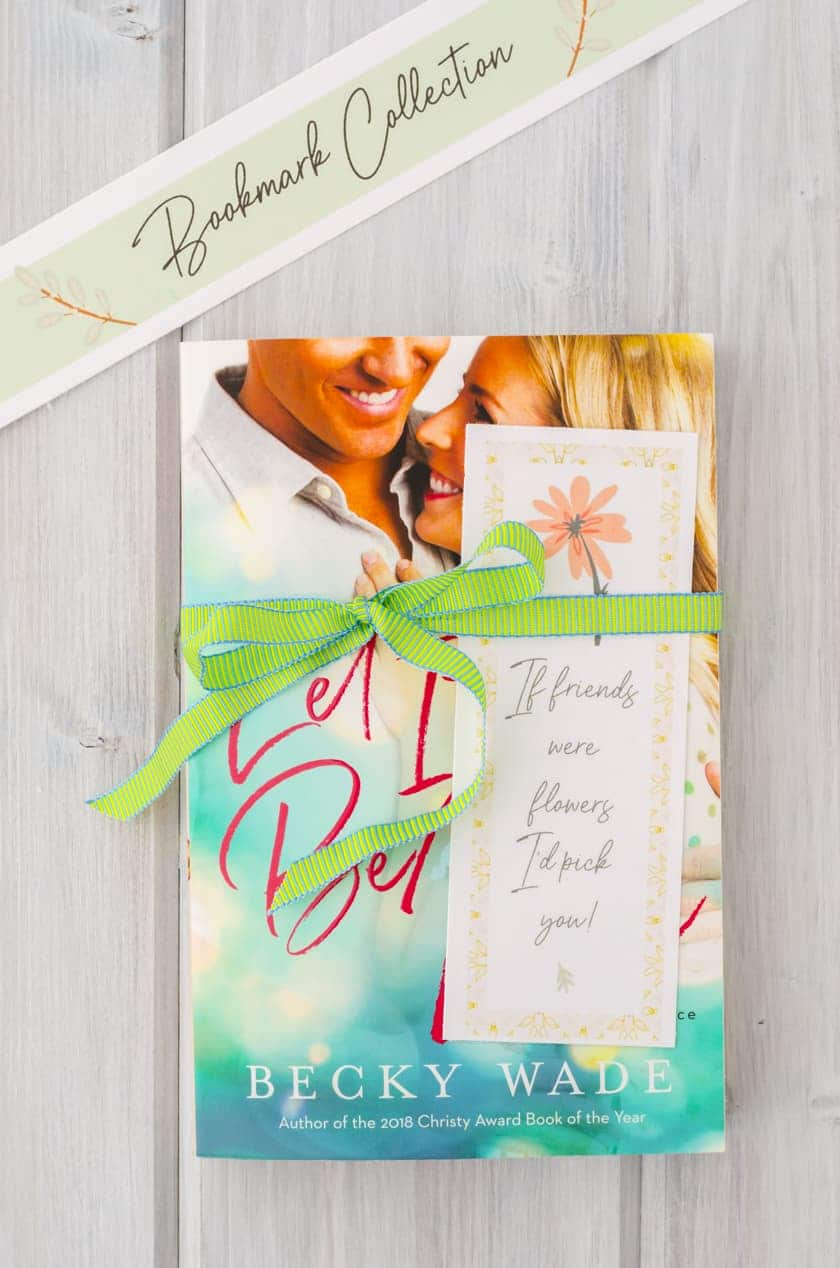 printable bookmark with friendship saying tied around a book.