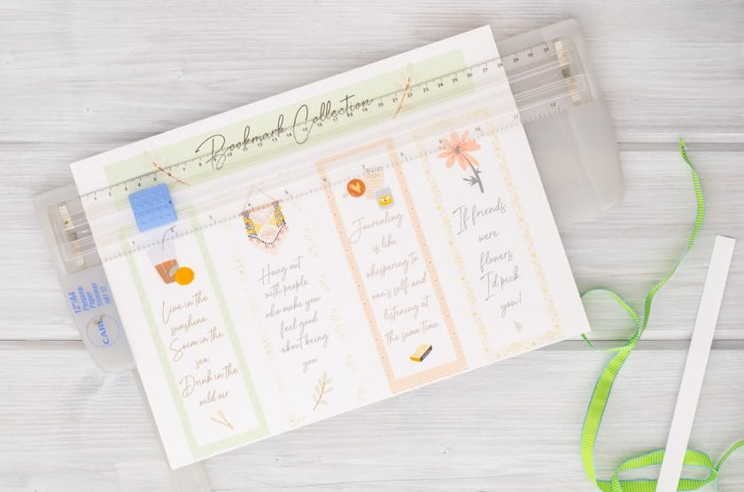 Set of 4 printable bookmarks for Summer, friends, and adult ladies being cut apart by a paper cutter.