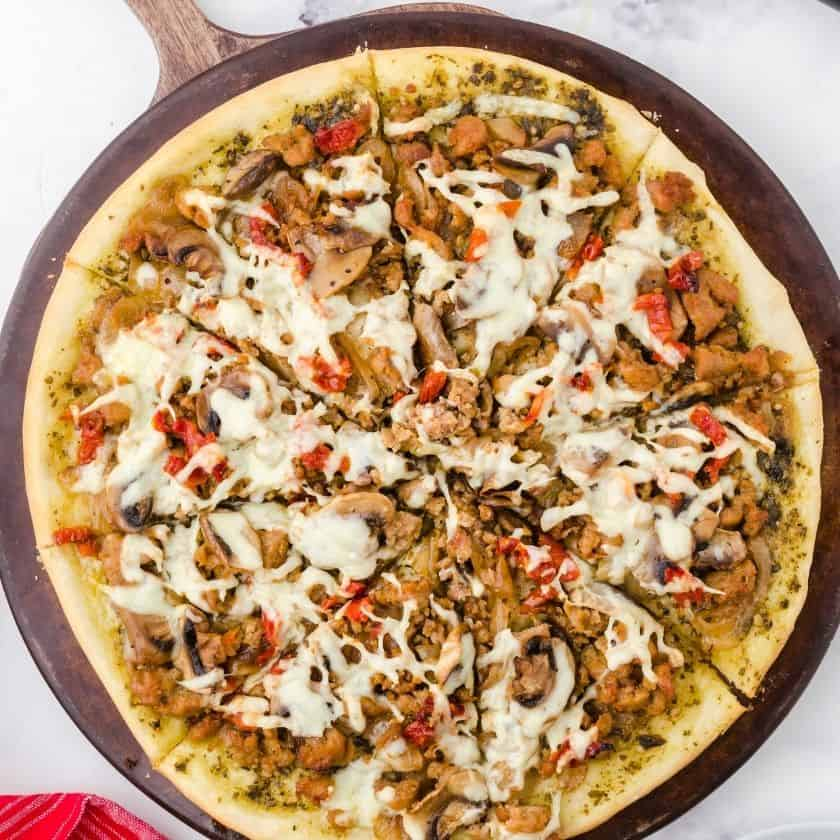 This Homemade Italian Sausage Pizza with Pesto Sauce is AMAZING!