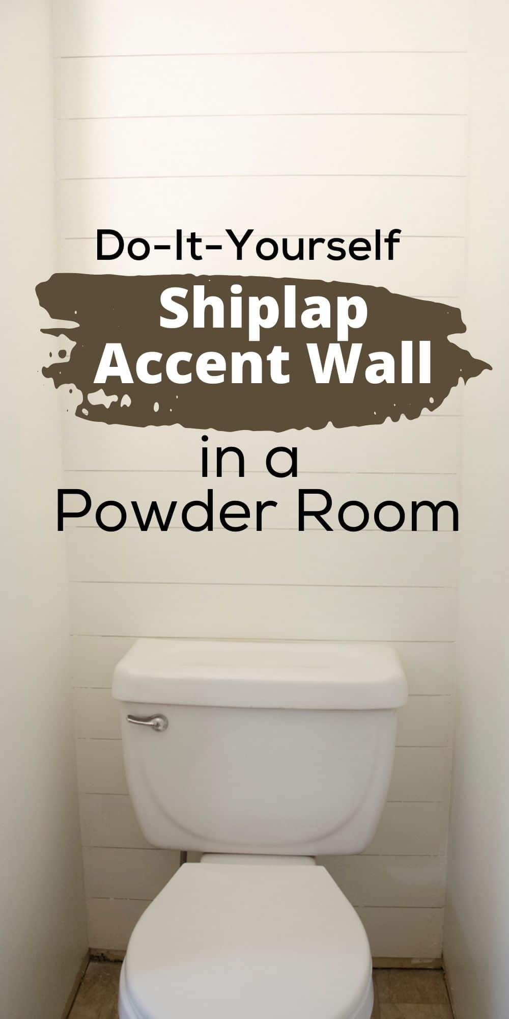 Shiplap accent wall in a powder room bathroom with a toilet in front of it.